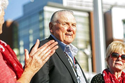 FILE - In this Sept. 13, 2014, file photo, Washington State alumnus Keith Jackson smiles after raising the Cougar flag before the start of an NCAA college football game against Portland State at Martin Stadium in Pullman, Wash. Jackson, the down-home voice of college football during more than five decades as a broadcaster, died Friday, Jan. 12, 2018. He was 89.