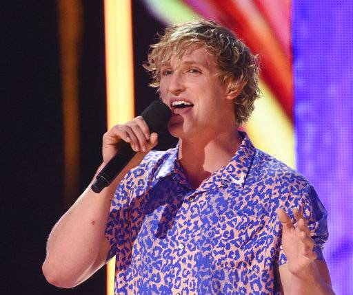 FILE - In this Aug. 13, 2017 file photo, Logan Paul speaks at the Teen Choice Awards at the Galen Center in Los Angeles. YouTube has suspended the star who posted video images of what appeared to be a suicide victim but said Saturday, Jan. 13, 2018 that doesn't mean it won't work with him in the future. (Photo by Phil McCarten/Invision/AP, File)
