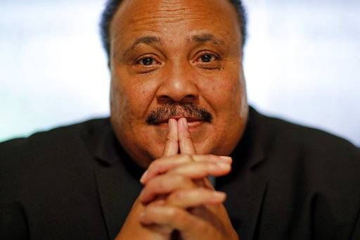 "Martin Luther King III, the son of Rev. Martin Luther King Jr., is photographed in Atlanta, Thursday, Jan. 11, 2018. ""I would like to believe that the president's intentions are not to be divisive, but much of what he says seems or feels to be divisive,"" King III told AP in an interview. ""It would be wonderful to have a president who talked about bringing America together and exhibited that, who was involved in doing a social project ... that would show humility."""