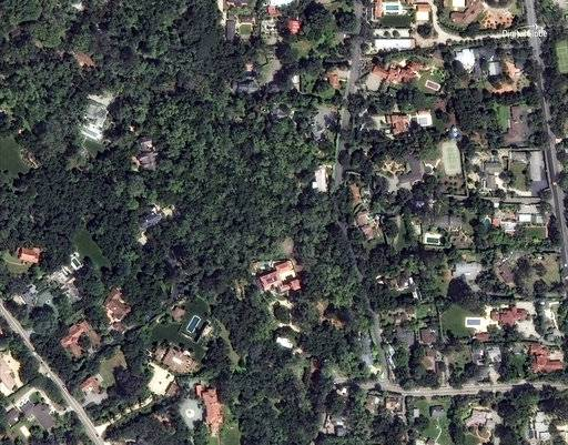 This April 8, 2017 satellite image released by DigitalGlobe News Bureau shows an area of homes in Montecito, Calif. The number of missing after a California mudslide has fluctuated wildly, due to shifting definitions, the inherent uncertainty that follows a natural disaster, and just plain human error. (DigitalGlobe News Bureau via AP)