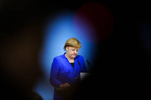 German Chancellor Angela Merkel attends a joint statement after the exploratory talks between Merkel's conservative bloc and the Social Democrats on forming a new German government in Berlin, Germany, Friday, Jan. 12, 2018.