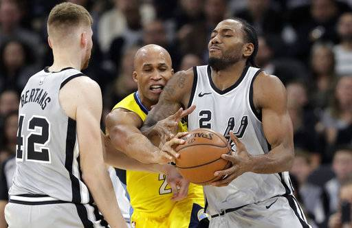 San Antonio Spurs forward Kawhi Leonard (2) is pressured by Denver Nuggets forward Richard Jefferson, center, during the first half of an NBA basketball game Saturday, Jan. 13, 2018, in San Antonio.