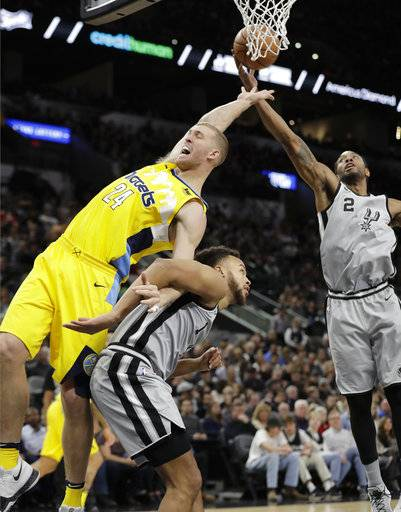 Denver Nuggets center Mason Plumlee (24) and San Antonio Spurs forwards Kyle Anderson (1) and Kawhi Leonard (2) vie for a rebound during the first half of an NBA basketball game, Saturday, Jan. 13, 2018, in San Antonio.