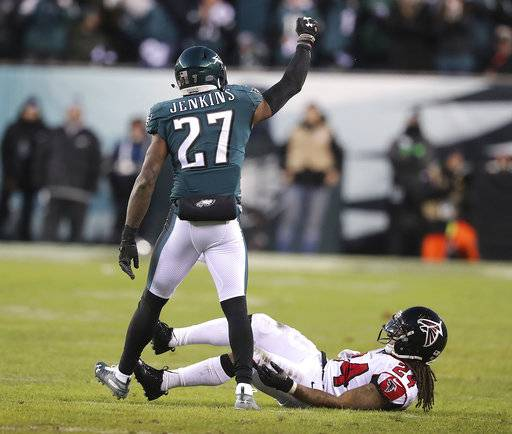 Philadelphia Eagles safety Malcolm Jenkins reacts to stopping Atlanta Falcons running back Devonta Freeman short of a first down on a fourth-down play during the first half of an NFL football NFC divisional playoff game Saturday, Jan. 13, 2018, in Philadelphia. The Eagles won 15-10. (Curtis Compton/Atlanta Journal-Constitution via AP)