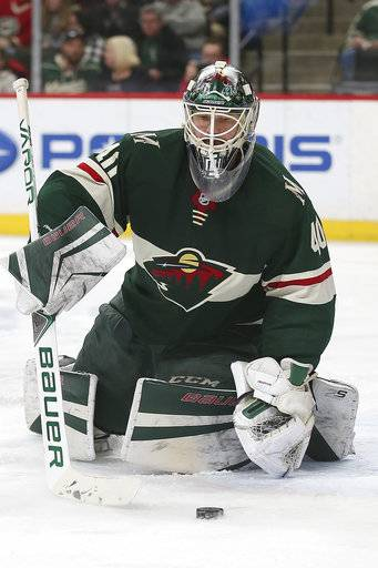 Minnesota Wild's goalie Devan Dubnyk (40) watches the puck in the second period of an NHL hockey game against the Winnipeg Jets, Saturday, Jan. 13, 2018, in St. Paul, Minn.