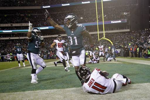 Philadelphia Eagles' Jalen Mills (31) and Brandon Graham (55) celebrate after Atlanta Falcons' Julio Jones (11) cannot catch a fourth down pass during the second half of an NFL divisional playoff football game, Saturday, Jan. 13, 2018, in Philadelphia. Philadelphia won 15-10. (AP Photo/Matt Rourke)