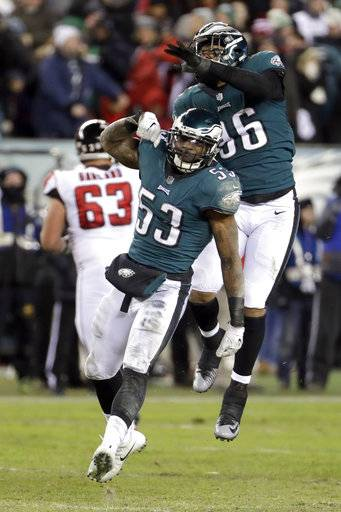 Philadelphia Eagles' Nigel Bradham (53) and Derek Barnett (96) celebrate during the second half of an NFL divisional playoff football game against the Atlanta Falcons, Saturday, Jan. 13, 2018, in Philadelphia.