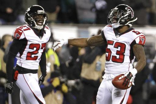 Atlanta Falcons' LaRoy Reynolds, right, and Damontae Kazee (27) react after recovering a fumbled punt during the first half of an NFL divisional playoff football game against the Philadelphia Eagles, Saturday, Jan. 13, 2018, in Philadelphia.