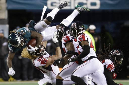 Philadelphia Eagles' Jay Ajayi (36) is tackled by Atlanta Falcons' Brooks Reed (50) during the first half of an NFL divisional playoff football game, Saturday, Jan. 13, 2018, in Philadelphia.