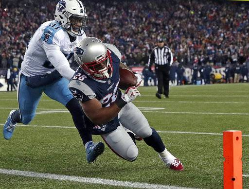 New England Patriots running back James White, right, runs past Tennessee Titans safety Kevin Byard (31) for a touchdown during the first half of an NFL divisional playoff football game, Saturday, Jan. 13, 2018, in Foxborough, Mass.