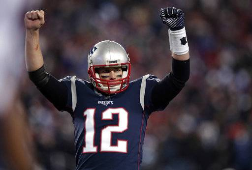New England Patriots quarterback Tom Brady celebrates a touchdown by James White during the first half of an NFL divisional playoff football game against the Tennessee Titans, Saturday, Jan. 13, 2018, in Foxborough, Mass.