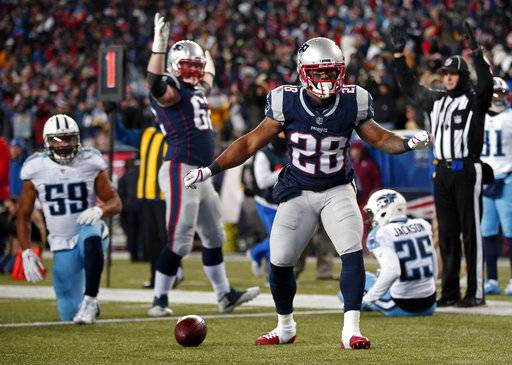 New England Patriots running back James White (28) celebrates his second touchdown during the first half of an NFL divisional playoff football game against the Tennessee Titans, Saturday, Jan. 13, 2018, in Foxborough, Mass.