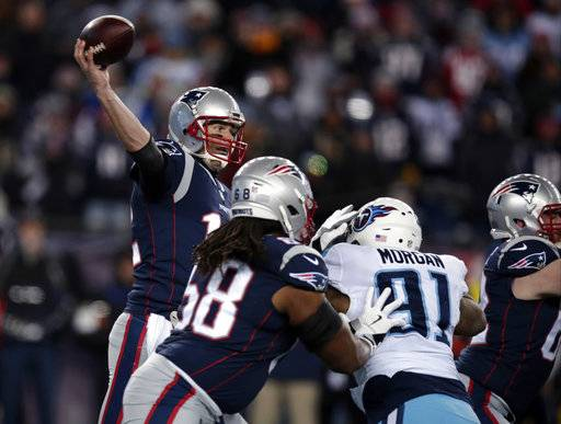 New England Patriots quarterback Tom Brady passes under pressure from Tennessee Titans linebacker Derrick Morgan (91) during the first half of an NFL divisional playoff football game, Saturday, Jan. 13, 2018, in Foxborough, Mass.