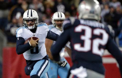 Tennessee Titans quarterback Marcus Mariota (8) scrambles against the New England Patriots during the first half of an NFL divisional playoff football game, Saturday, Jan. 13, 2018, in Foxborough, Mass.