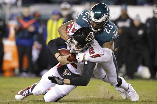 Philadelphia Eagles' Rodney McLeod (23) tackles Atlanta Falcons' Matt Ryan (2) during the second half of an NFL divisional playoff football game, Saturday, Jan. 13, 2018, in Philadelphia.