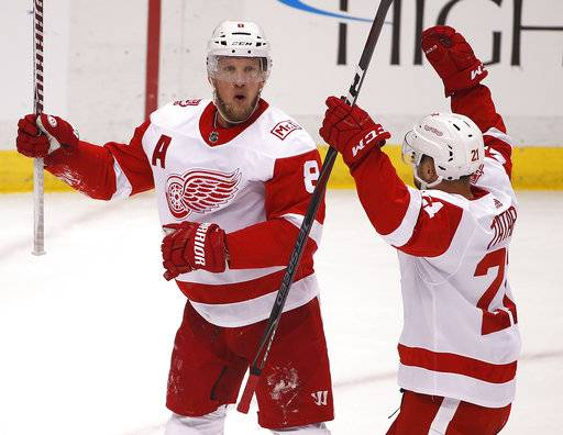 Detroit Red Wings' Justin Abdelkader (8) celebrates his goal with Tomas Tatar (21) in the first period of an NHL hockey game against the Pittsburgh Penguins in Pittsburgh, Saturday, Jan. 13, 2018.