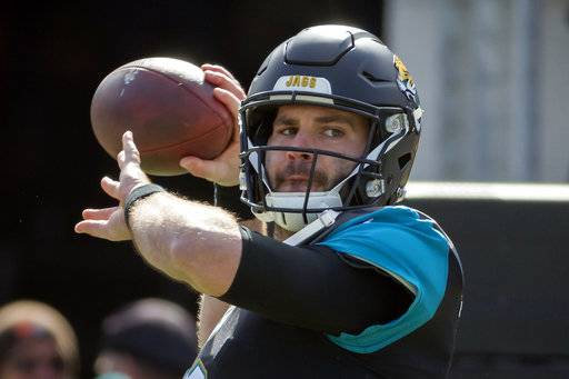 FILE - In this Sunday, Jan. 7, 2018 file photo, Jacksonville Jaguars quarterback Blake Bortles (5) warms up before the start of an NFL wild-card playoff football game against the Buffalo Bills in Jacksonville, Fla. Blake Bortles' first postseason victory came with a hefty dose of criticism, maybe even more than ever before. The Jacksonville Jaguars quarterback handled it as well as he did Buffalo's pass rush.