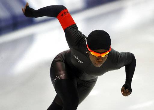 FILE - In this Jan. 5, 2018, file photo, Erin Jackson competes in the women's 500 meters during the U.S. Olympic long track speedskating trials in Milwaukee. Jackson, a former inliner, is the first black female skater to make a U.S. Olympic long track team.