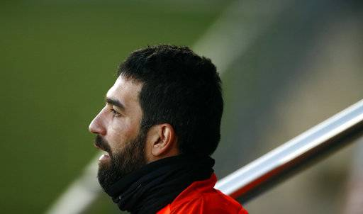 FILE - In this Monday, Dec. 4, 2017 file photo, FC Barcelona's Arda Turan takes part in a training session at the Sports Center FC Barcelona Joan Gamper in Sant Joan Despi, Spain. Barcelona says Arda Turan will play on loan with Turkish club Istanbul Basaksehir for the rest of this season and two more.