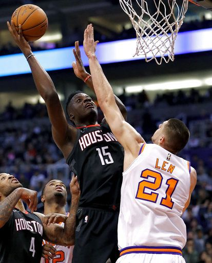 fe83fcce97c1 Houston Rockets center Clint Capela (15) shoots over Phoenix Suns center  Alex Len (