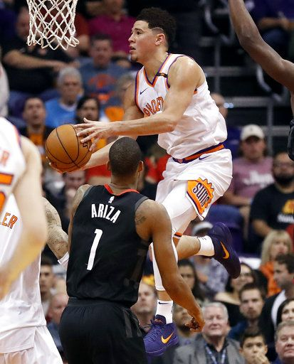 7eca79802c73 Phoenix Suns guard Devin Booker drives over Houston Rockets forward Trevor  Ariza (1) during