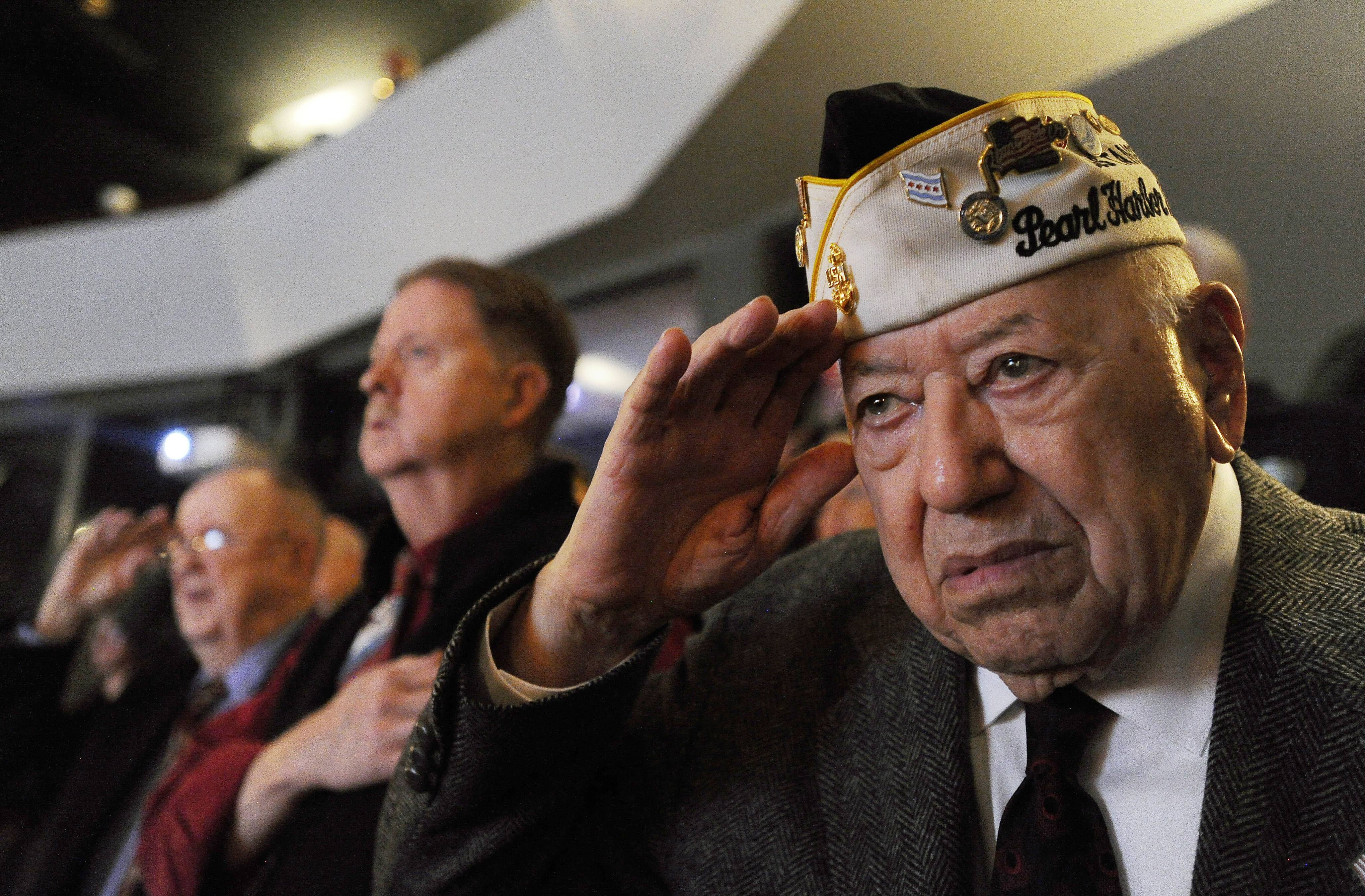 Pearl Harbor survivor Joe Triolo, 95, of Zion, salutes during the Remembrance Day Ceremony at Prairie Lakes Theater in Des Plaines in 2015.