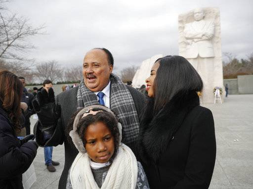 Martin Luther King III,with his wife Arndrea Waters, and their daughter Yolanda, 9, during their visit to the Martin Luther King Jr., Memorial on the National Mall in Washington, Monday, Jan. 15, 2018. The son of the late U.S. civil rights activist Martin Luther King Jr., and his family had earlier participated in an event commemorating the life and legacy of his father.