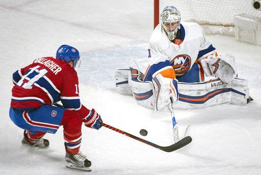 Montreal Canadiens right wing Brendan Gallagher (11) moves in against New York Islanders goaltender Thomas Greiss (1) during second-period NHL hockey game action in Montreal, Monday, Jan. 15, 2018. (Graham Hughes/The Canadian Press via AP)