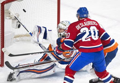New York Islanders goaltender Thomas Greiss (1) is scored on by Montreal Canadiens left wing Nicolas Deslauriers (20) during first-period NHL hockey game action in Montreal, Monday, Jan. 15, 2018. (Graham Hughes/The Canadian Press via AP)