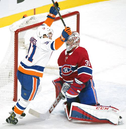 New York Islanders center John Tavares (91) celebrates after scoring against Montreal Canadiens goaltender Carey Price (31) during the overtime period of an NHL hockey game in Montreal, Monday, Jan. 15, 2018. (Graham Hughes/The Canadian Press via AP)