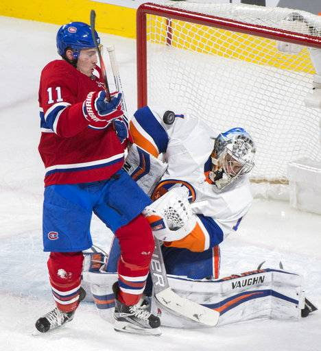 New York Islanders goaltender Thomas Greiss (1) makes a save against Montreal Canadiens right wing Brendan Gallagher (11) during second-period NHL hockey game action in Montreal, Monday, Jan. 15, 2018. (Graham Hughes/The Canadian Press via AP)