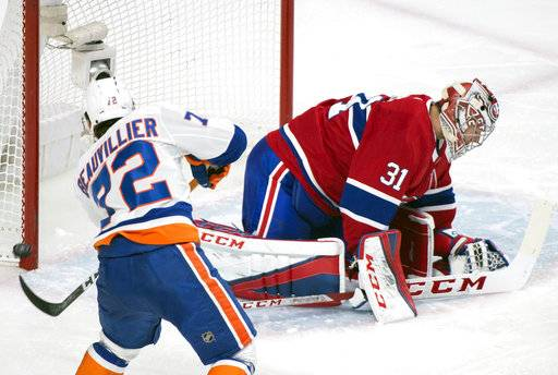 Montreal Canadiens goaltender Carey Price (31) is scored against by New York Islanders defenseman Adam Pelech (not shown) as Islanders center Anthony Beauvillier (72) taps the rebound back in during second-period NHL hockey game action in Montreal, Monday, Jan. 15, 2018. (Graham Hughes/The Canadian Press via AP)