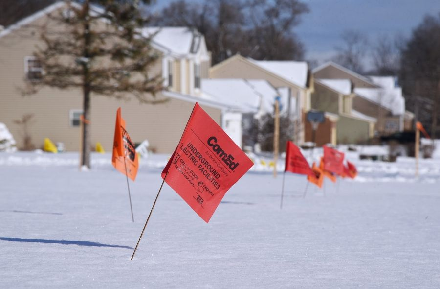 Utility flags mark the area where the Millburn bypass will be built crossing Haven Lane in the Forest Trail subdivision near Lindenhurst.