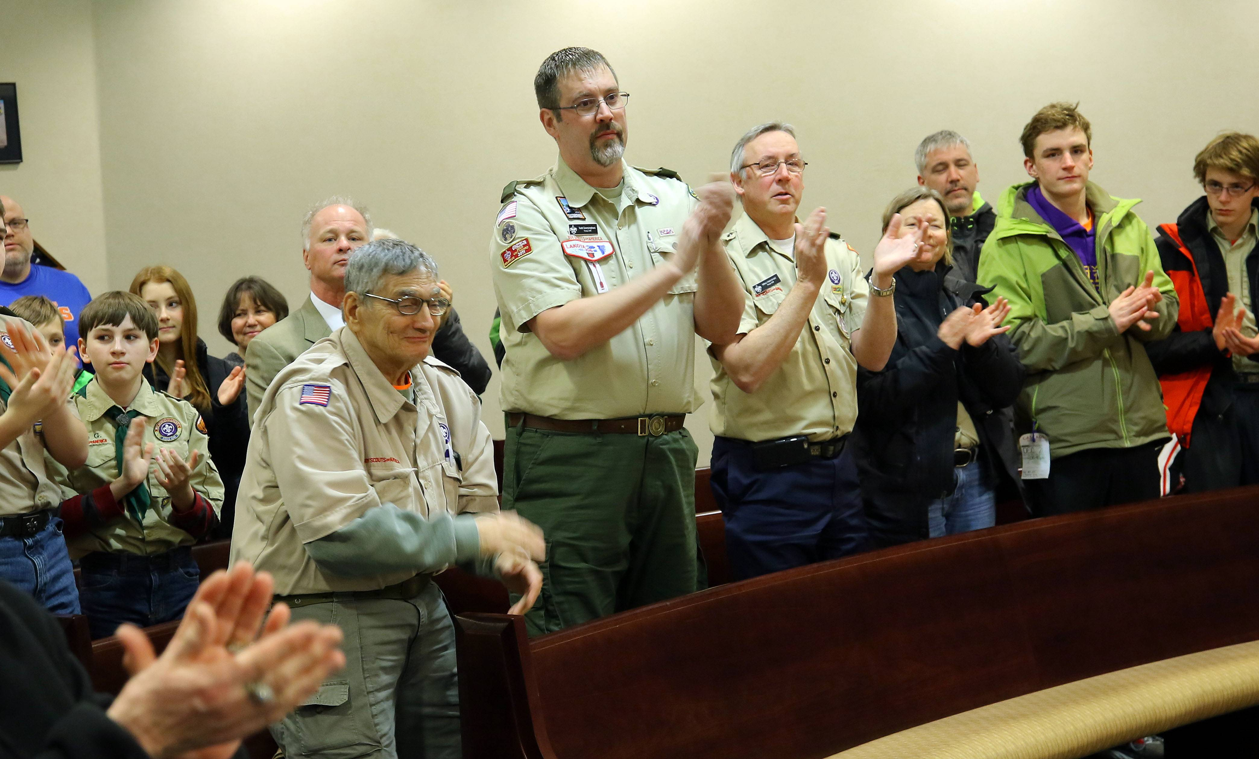Audience members, including members of Boy Scout Troop 209 in Palatine, clap after Tyler Matuszczak of Hoffman Estates receives a Citizen Lifesaving Award at Monday's Hoffman Estates village board meeting.