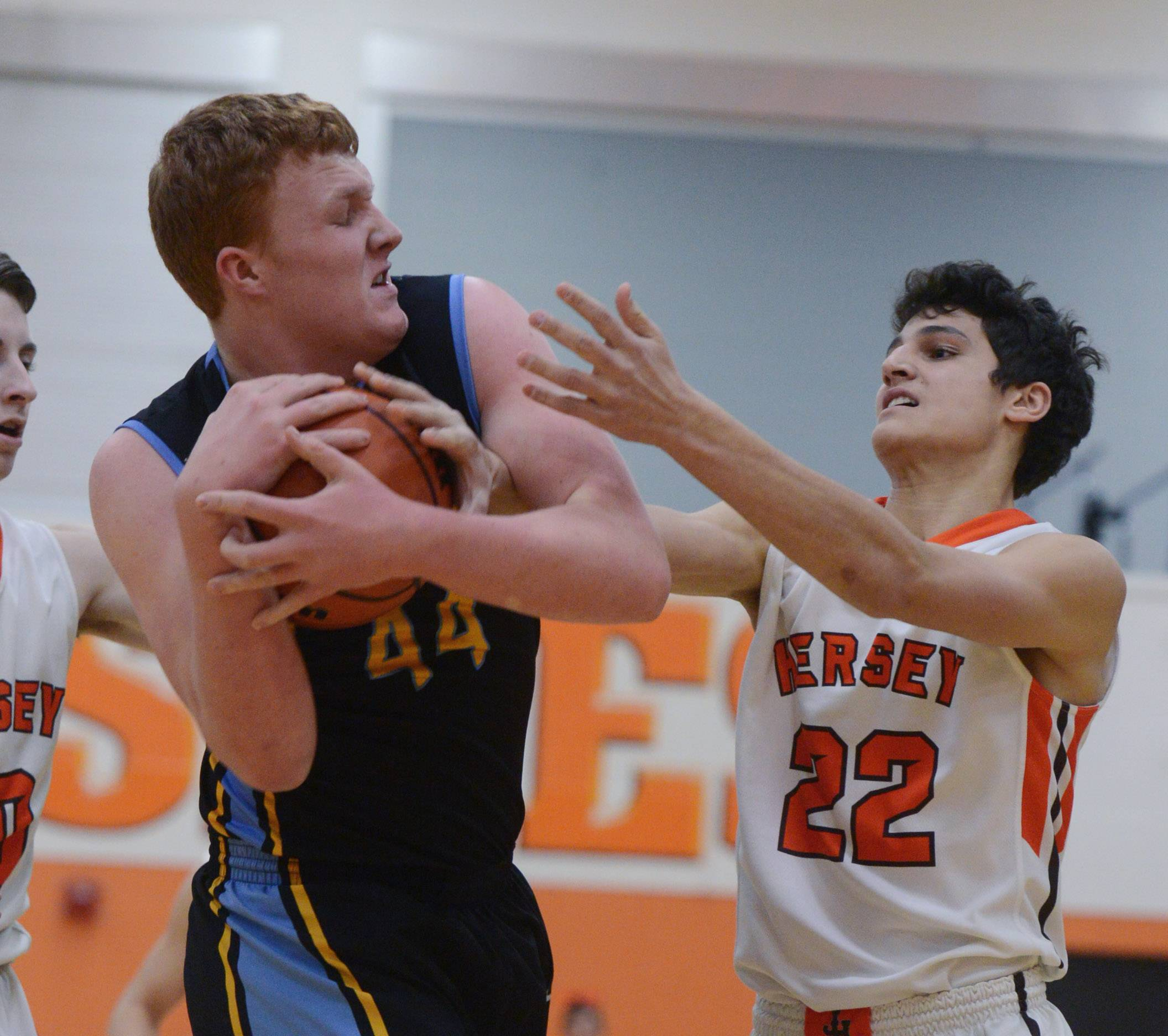 Maine West's Jack Collins, left, grabs a rebound in front of Hersey's Jace Coffaro.