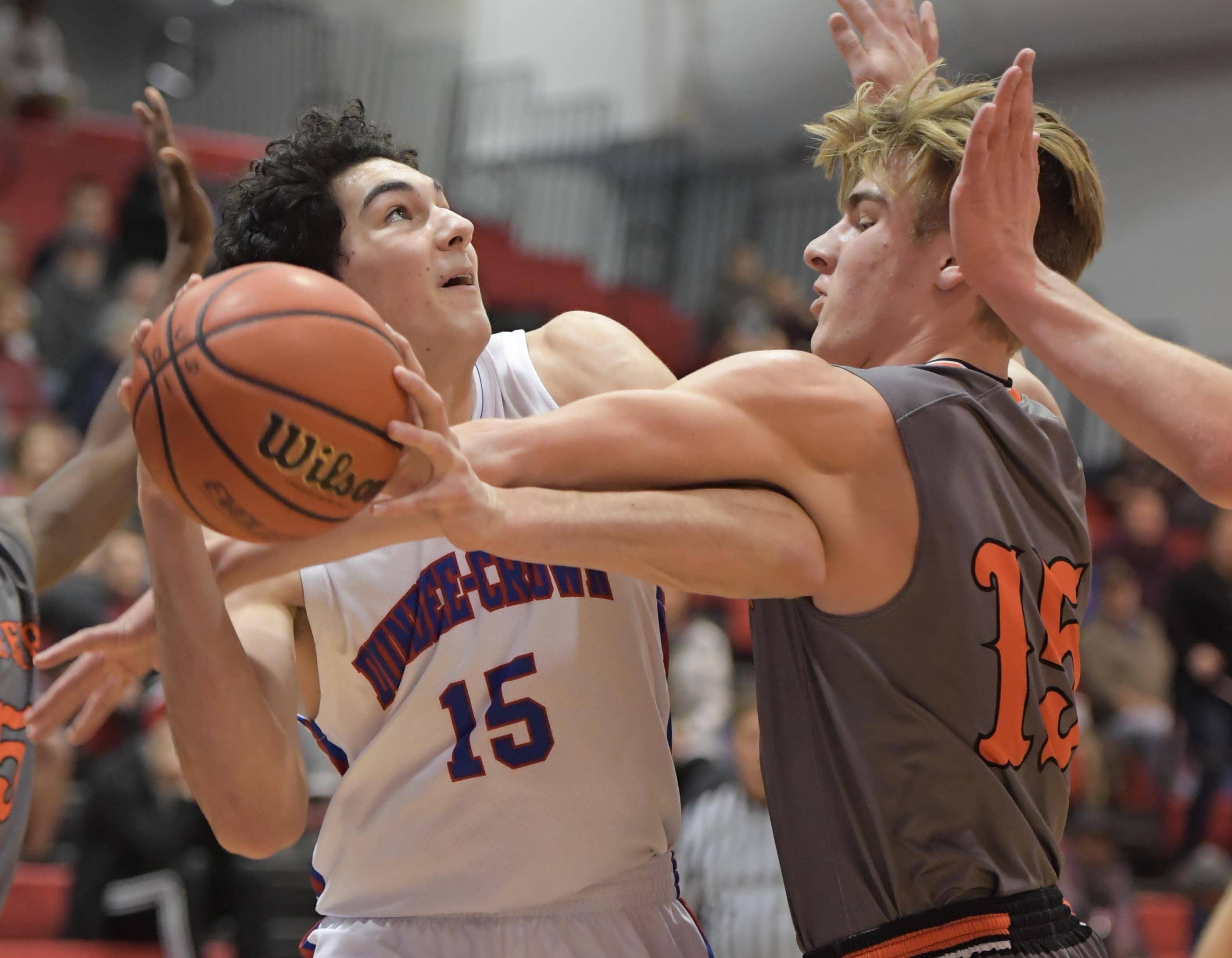 Dundee-Crown's Gabriel Bergeron is fouled by McHenry's Matt Ezop Wednesday at Carpentersville.