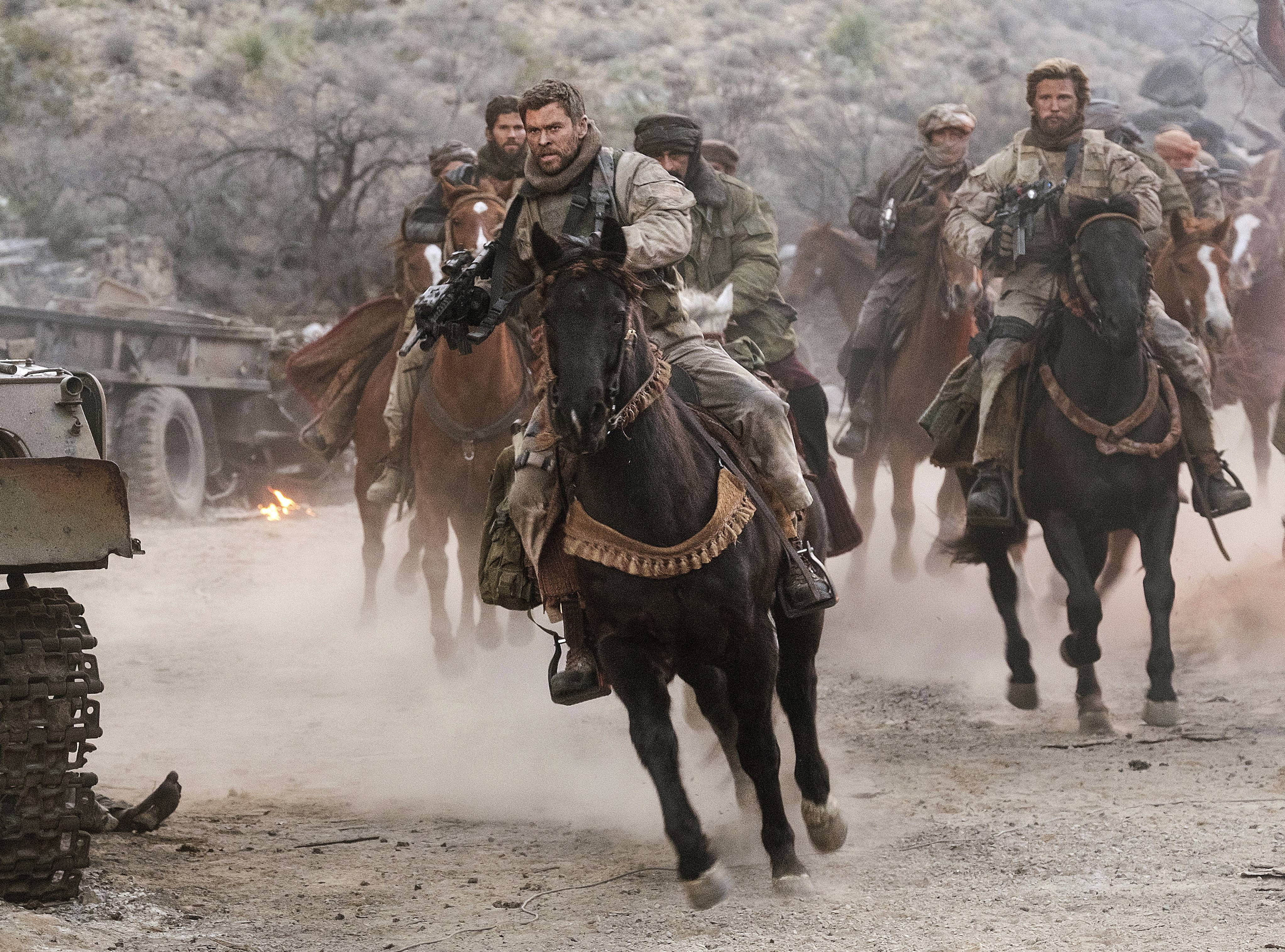 "Capt. Mitch Nelson (Chris Hemsworth) leads his band of brothers under difficult circumstances in ""12 Strong."""
