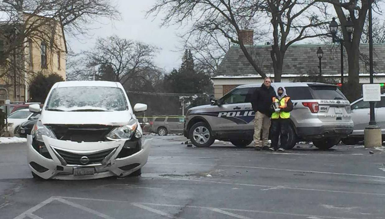 Police officials investigate a fatal double shooting Jan. 3 in a Lake Forest parking lot. Authorities now say it was a murder-suicide involving a Kentucky man who shot a Lake Forest woman, then turned the gun on himself.