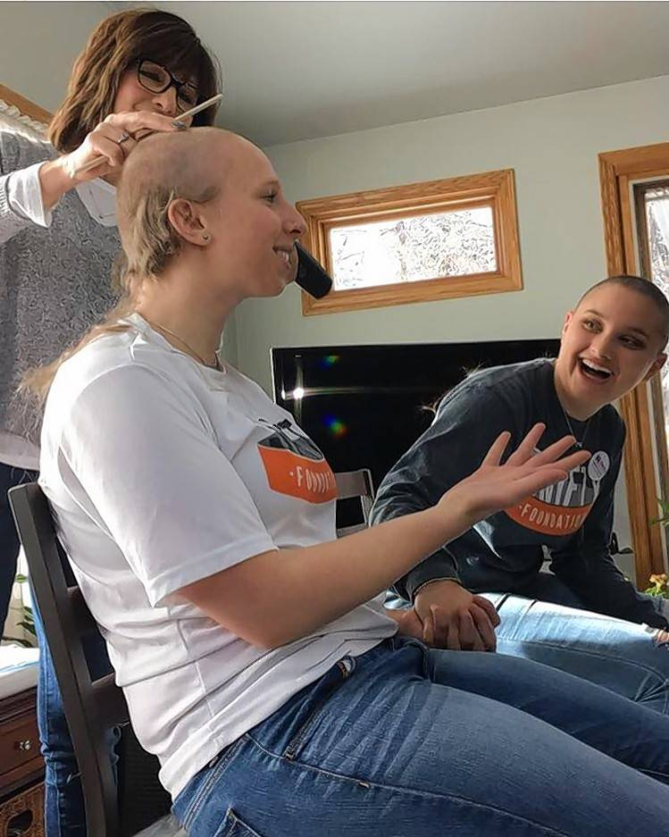"Caitlin Holzer of Naperville gets her head shaved Jan. 6 to raise money for the Swifty Foundation, which was formed in honor of her late Naperville North High School classmate Michael ""Mikey"" Gustafson, who died in 2013 of a brain tumor at age 15."