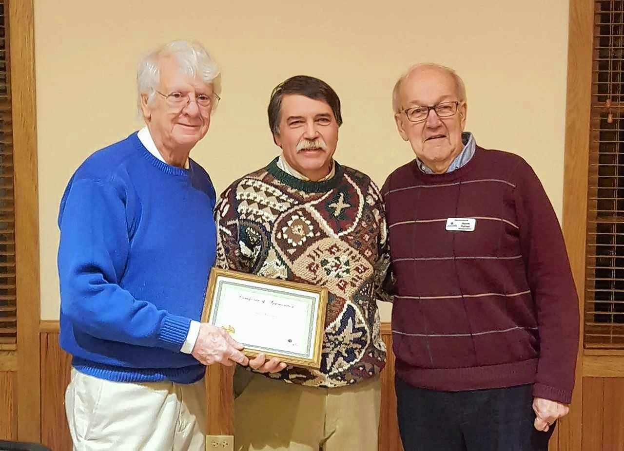 Campton Hills Village President Harry Blecker, left, presents Neal Anderson, center, with the Outstanding Citizen award Tuesday night, along with Norm Turner of the village's Community Relations Committee.