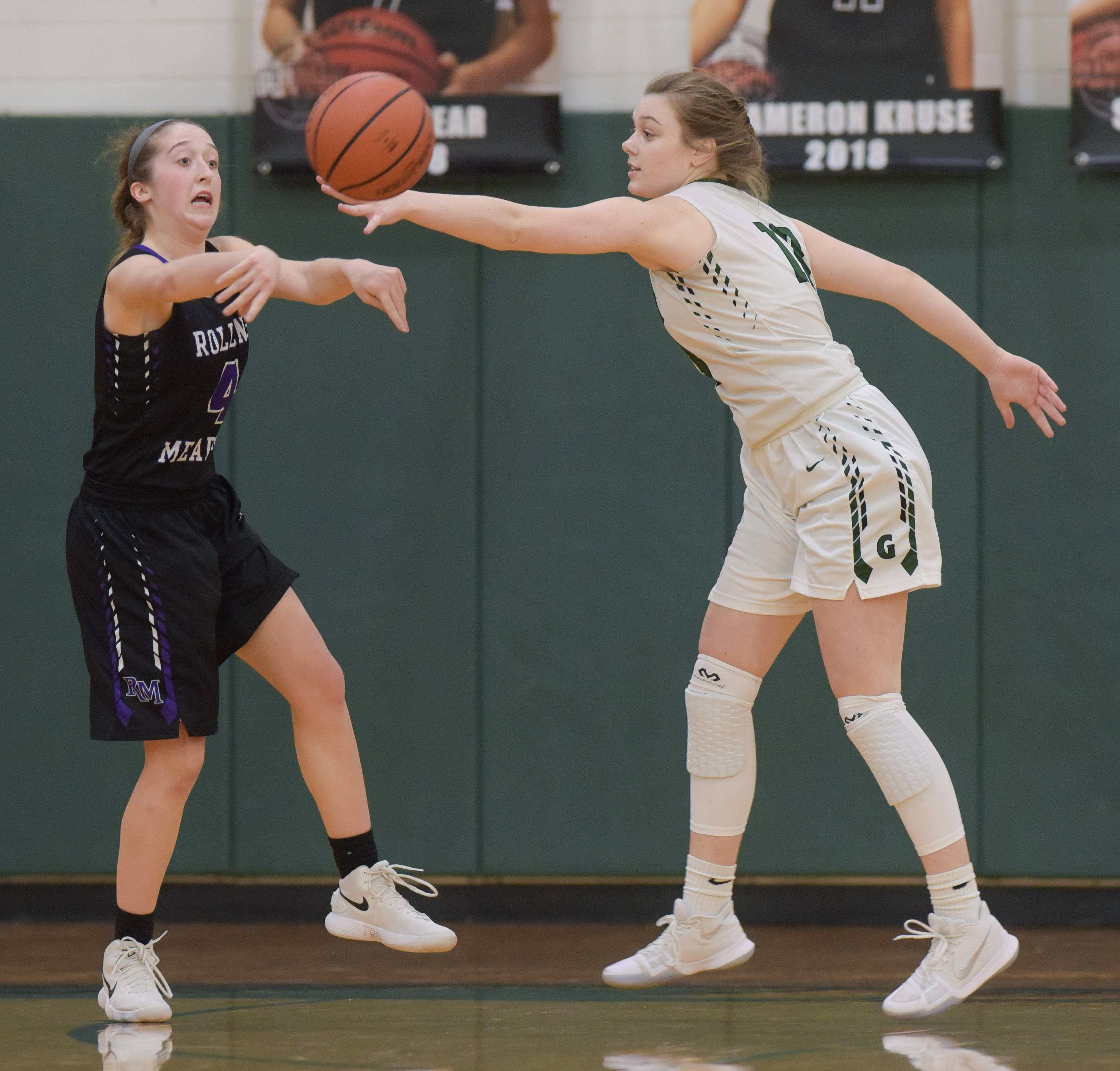 Rolling Meadows' Melissa Spiwak (4) attempts to pass the ball around Glenbard West's Maggie Stutelberg (13) during varsity girls basketball in Glen Ellyn on January 17, 2018.