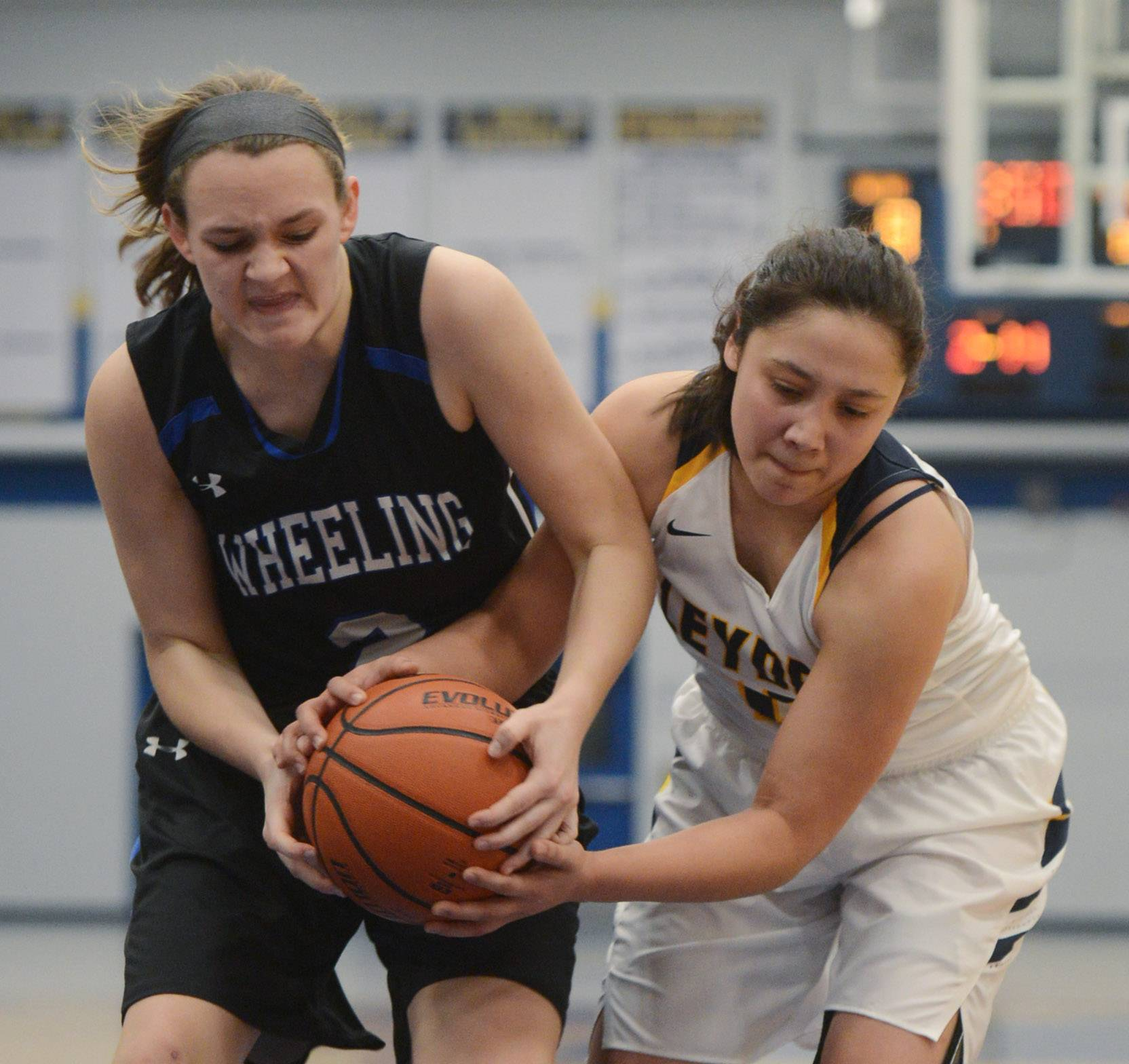Wheeling's Morgan Collar, left, and Leyden's Alyssa Simi battle for the ball.