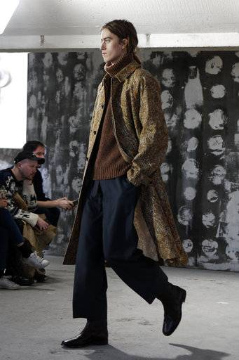 A model wears a creation for Christophe Lemaire' s men Fall-Winter 2018/2019 fashion collection presented in Paris, Wednesday, Jan.17, 2018. (AP Photo/Francois Mori)