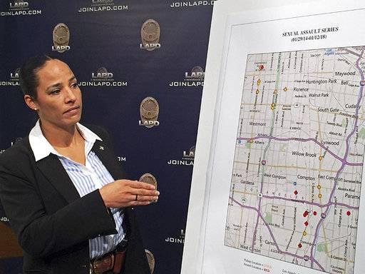 Los Angeles Police Det. Dara E. Brown shows a map of locations where an alleged serial rapist is believed to have attacked his victims, at a news conference at LAPD headquarters in downtown Los Angeles Wednesday, Jan. 17, 2018. Officials say police and Los Angeles County Sheriff's deputies arrested a man they describe as a serial rapist when they saw a victim who had fought him off fall from his car on Friday, Jan. 12. He was identified as 35-year-old Ferdinand Ervin Flowers of Long Beach. (AP Photo/Robert Jablon)