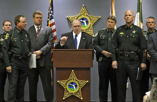 U.S. Immigration and Customs Enforcement Deputy Director Thomas Homan, center, gestures as he is surrounded by several Florida sheriffs during a news conference Wednesday, Jan. 17, 2018, in Largo, Fla. U.S. Immigration and Customs Enforcement officials joined the sheriffs to announce new efforts to enhance public safety. (AP Photo/Chris O'Meara)