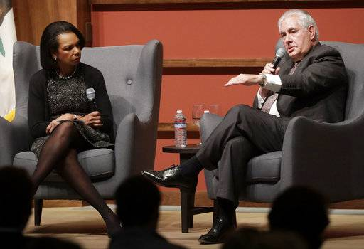 Secretary of State Rex Tillerson, right, speaks with former Secretary of State Condoleeza Rice at the Hoover Institution at Stanford University in Stanford, Calif., Wednesday, Jan. 17, 2018. In a speech at Stanford University, Tillerson signaled a deeper American commitment to the Mideast nation of Syria, saying the U.S. military will remain there for the foreseeable future. (AP Photo/Jeff Chiu)