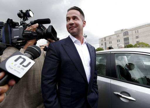 "FILE - In this Sept. 24, 2014, file photo, reporters gather around Mike ""The Situation"" Sorrentino as he leaves the MLK Jr. Federal Courthouse in Newark, N.J., after a court appearance. Former ""Jersey Shore� reality TV star Sorrentino is expected to plead guilty to federal tax charges. A letter filed with the court on Wednesday, Jan. 17, 2018, said Sorrentino and his brother, Marc, plan to plead guilty at a court hearing on Friday in Newark. The pair was charged in 2014 with filing bogus tax returns on nearly $9 million in income. Additional charges were filed last April. (AP Photo/Julio Cortez, File)"