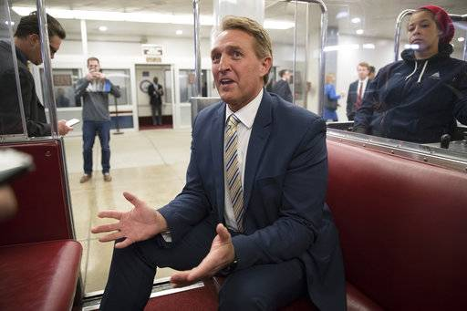 "Sen. Jeff Flake, R-Ariz., talks to reporters just after a blistering speech on the Senate floor aimed at President Donald Trump, at the Capitol in Washington, Wednesday, Jan. 17, 2018.  In a speech on the Senate floor, Flake called Trump's repeated attacks on the media ""shameful� and ""repulsive� and said Trump ""has it precisely backward.'' Flake said despotism is the enemy of the people, while a free press is the despot's enemy and a guardian of democracy."
