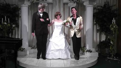 In this Oct. 29, 2011, image made from a video provided by A Elvis Chapel, David Allen Turpin, left, and his wife, Louise Anna Turpin, center, celebrate a renewal of their wedding vows with Elvis impersonator Kent Ripley in Las Vegas. The couple was arrested Sunday, Jan. 14, 2018, after authorities found their malnourished children in their home in suburban Perris, Calif., 60 miles (96 kilometers) southeast of Los Angeles. The couples' children were so emaciated the older ones still looked like children. (A Elvis Chapel via AP)