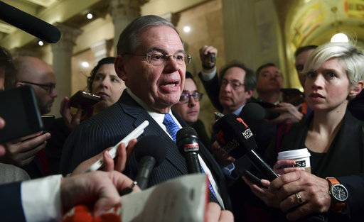 Sen. Bob Menendez, D-N.J., speaks with reporters on Capitol Hill in Washington, Wednesday, Jan. 17, 2018, following a meeting with the Congressional Hispanic Caucus and White House Chief of Staff John Kelly. (AP Photo/Susan Walsh)